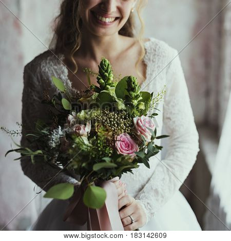 Attractive Beautiful Bride Holding Flowers Bouquet