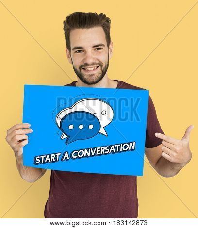 A man hold a card with message