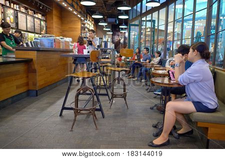 BANGKOK, THAILAND - JUNE 21, 2015: inside a Starbucks Cafe in Bangkok.