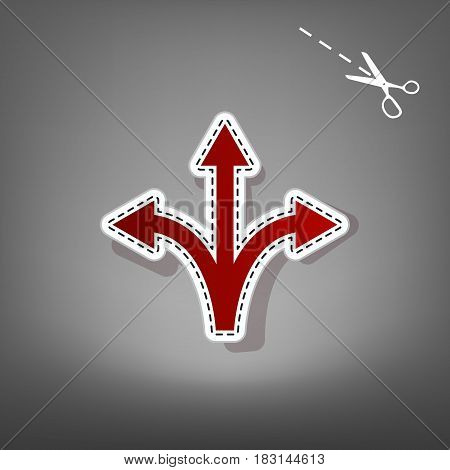 Three-way direction arrow sign. Vector. Red icon with for applique from paper with shadow on gray background with scissors.