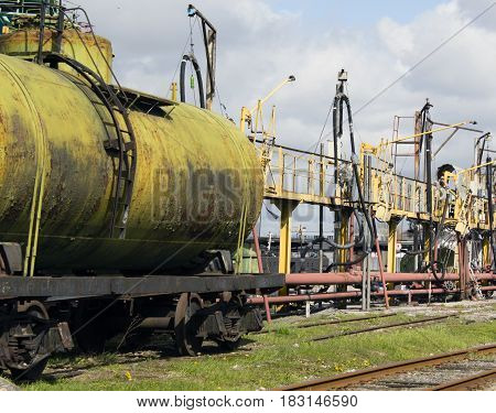 old railroad tank. The filling complex. Illegal extraction of oil.