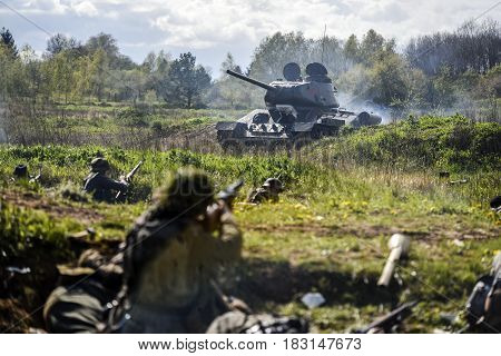 German soldiers and russian tank. Historical reconstruction soldiers fighting during World War II