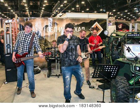 St. Petersburg Russia - 15 April, Rock musicians at the motor depot,15 April, 2017. International Motor Show IMIS-2017 in Expoforurum. Visitors and participants of the annual moto-salon in St. Petersburg.