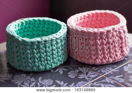 Baskets - turquoise and pink crochet around the circle of knitting yarn, made of cloth.Close