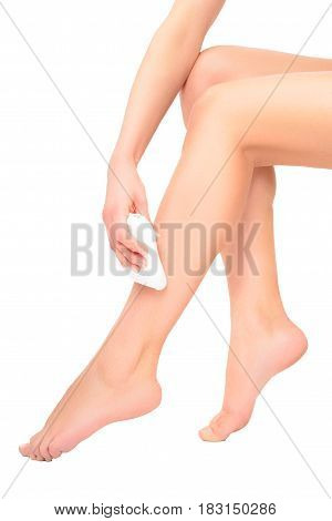 Beautiful slim female legs with the epilator, isolated on a white background