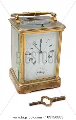 Vintage bronze clock on a white background
