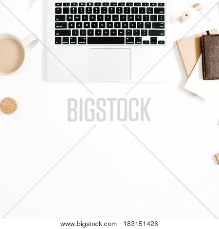Blogger or freelancer workspace with laptop coffee mug notebook and accessories on white background. Flat lay top view minimalistic brown styled home office desk. Beauty blog concept.