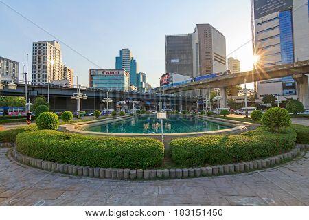 Bangkok , Thailand - April 20, 2017 : Sunset  view behind the city at the Lumpini park in Bangkok