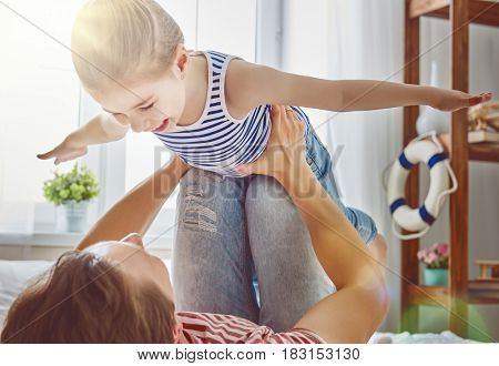 Happy father's day! Dad and his daughter child girl are playing, smiling and hugging. Family holiday and togetherness.