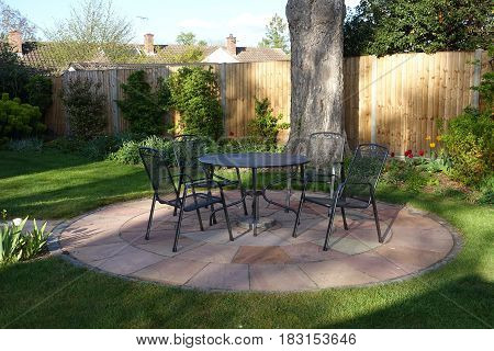 Patio in an English garden in the evening light