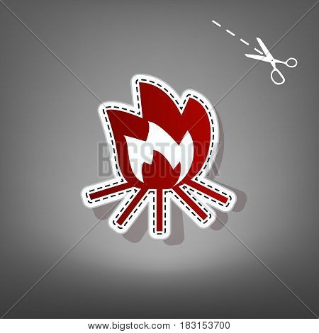 Fire sign. Vector. Red icon with for applique from paper with shadow on gray background with scissors.