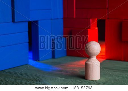 Choice concept. Abstract business person and two doors blue and red doubtful. The man hesitates before choosing. Businessman standing in front of two doors unable to make the right decision.
