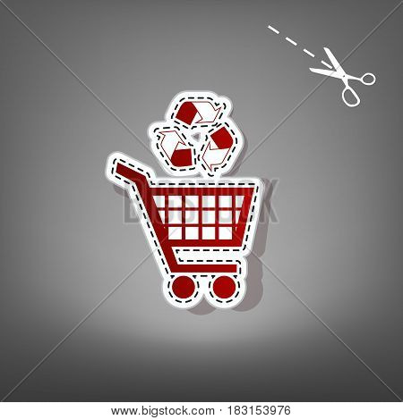 Shopping cart icon with a recycle sign. Vector. Red icon with for applique from paper with shadow on gray background with scissors.