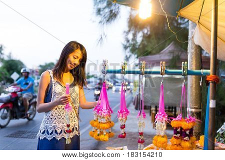 Woman buying flower at street