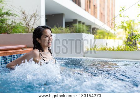 Young Woman enjoy in jacuzzi pool