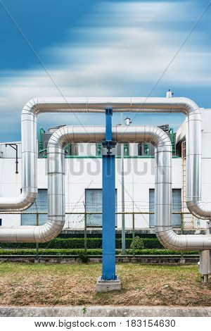 Steam distribution pipeline on factories background., Pipeline support