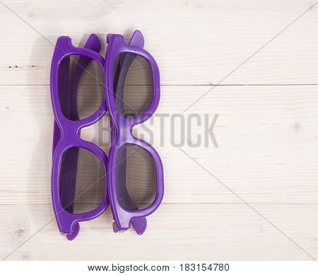 Two 3d glasses on a wooden background