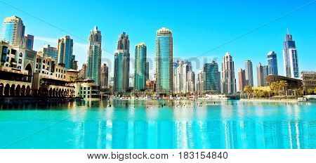 Downtown Dubai skyline panoramic view from the Dubai fountain. Modern city cityscape with skyscrapers sunny day.