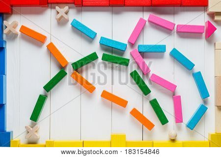 Choosing the right path. Business background the concept of logical thinking. The choice of the right path from the four roads is green orange blue and pink the top view flat lay.