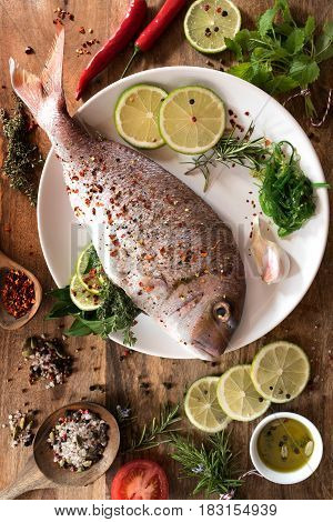 Fish raw with spices and herbs for frying or grilling