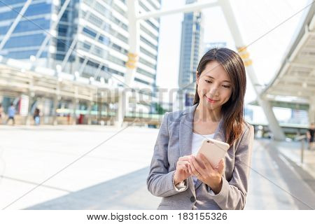 Businesswoman using cellphone at outdoor