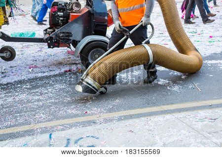 Street cleaner with industrial vacuum cleaner. Municipal cleaning service, clean streets