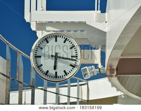 The clock on cruise ship deck. Open deck