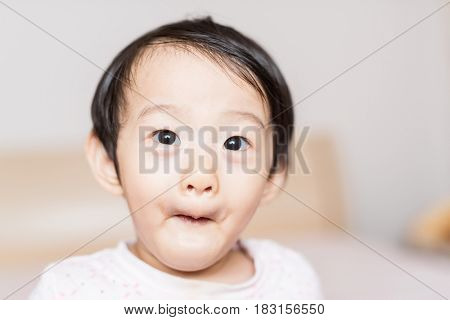 Adorable and expressive asian girl grimace