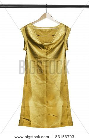 Yellow satin tunic dress on wooden clothes rack isolated over white