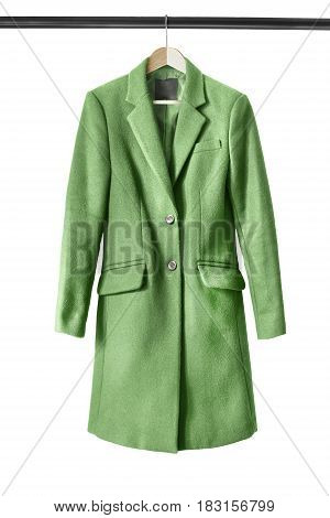 Green wool coat on wooden clothes rack isolated over white
