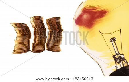 Bulb and coins on a white background