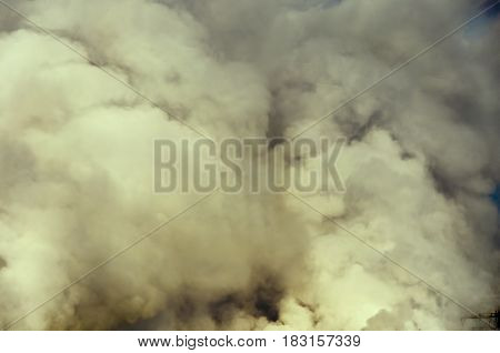 puffs of vapor of greenish color close up abstract background
