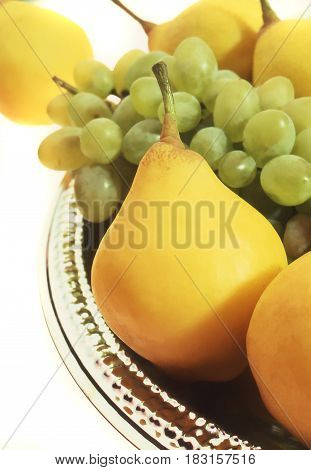 Pear and grapes on a white background