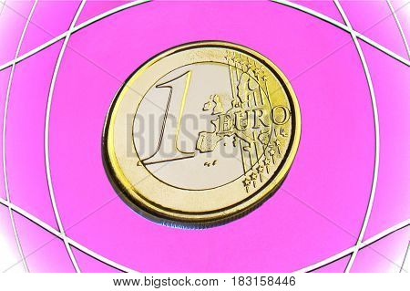 coin 1 euro on a pink background
