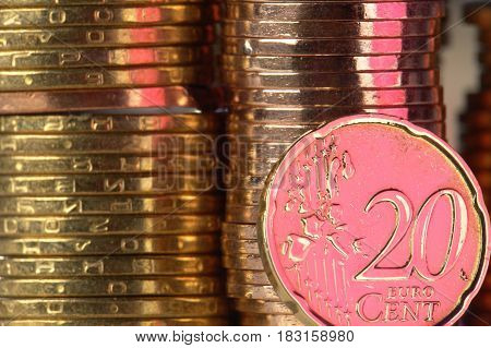 20 euro a coin on a background of coins