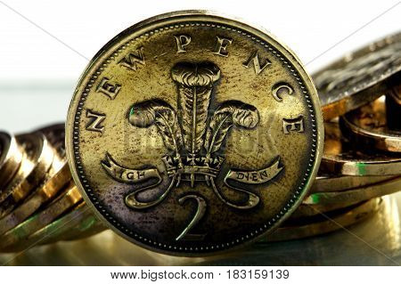 Pence coin on a background of coins