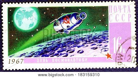 USSR - CIRCA 1967: Postage stamp printed in USSR shows Soviet spaceship on Moon orbit, with an inscription