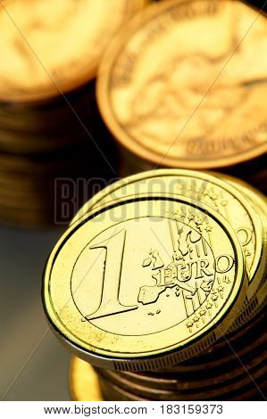 1 euro a coin on a background of coins