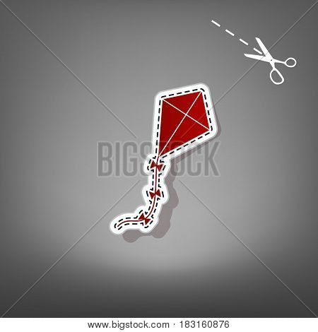 Kite sign. Vector. Red icon with for applique from paper with shadow on gray background with scissors.