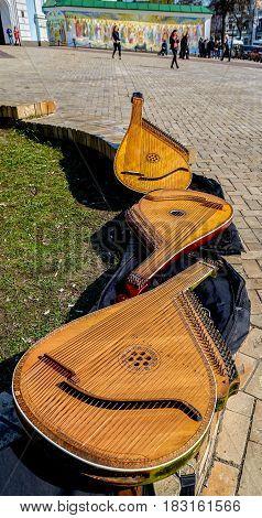 Three bandura ( pandora ) on the bench