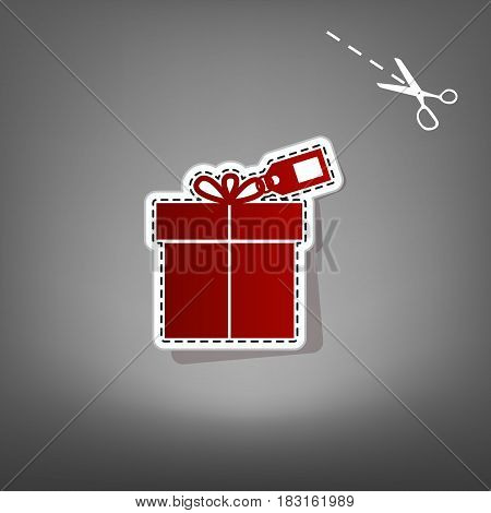 Gift sign with tag. Vector. Red icon with for applique from paper with shadow on gray background with scissors.