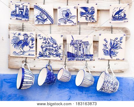 Traditional Portuguese pottery sold as souvenirs in Obidos.