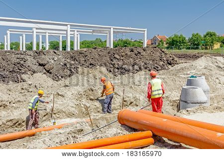 Zrenjanin, Vojvodina, Serbia - May 30, 2015: Arranged PVC of water pipes are assembled and placed in trench on building site.