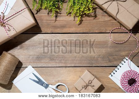 Present box on wooden table. Flat lay with copy space. Celebration holiday season and winter concept