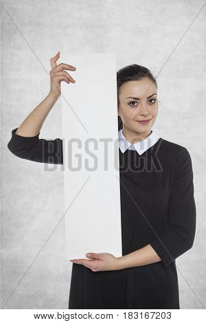 Beautiful Woman Holding A Blank Billboard, Space For Advertising
