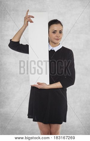 Beautiful Woman Holding A Blank Billboard, Space For Ad