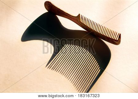 Hairbrush and shadow on a white  background