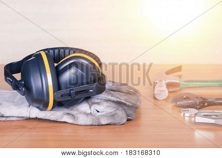 Standard Construction Safety And Construction Tools On Wooden Background