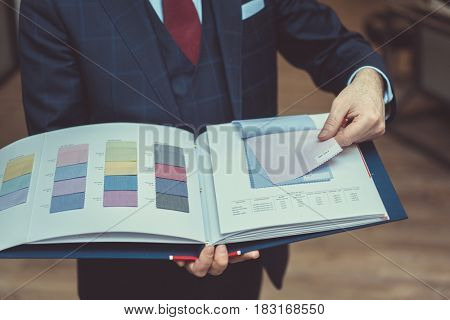 Man is holding a book