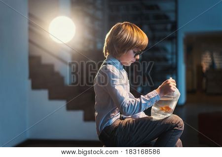 Little boy with goldfish